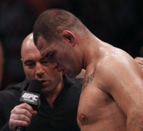 Oct 19, 2013; Houston, TX, USA; Cain Velasquez (red gloves) is interviewed by commentator Joe Rogan following the world heavyweight championship bout during UFC 166 at Toyota Center. Mandatory Credit: Andrew Richardson-USA TODAY Sports