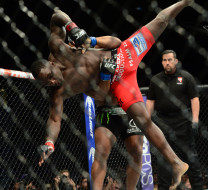 May 23, 2015; Las Vegas, NV, USA; Anthony Johnson (red gloves) and Daniel Cormier (blue gloves) fight during their light heavyweight championship bout during UFC 187 at MGM Grand Garden Arena. Cormier won via third round TKO. Mandatory Credit: Joe Camporeale-USA TODAY Sports